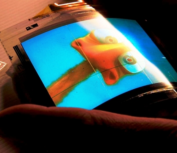 A new manufacturing process developed at the Flexible Display Center at Arizona State University promises to provide an effective method for mass production of flexible electronic devices capable of displaying full-color, full–motion video