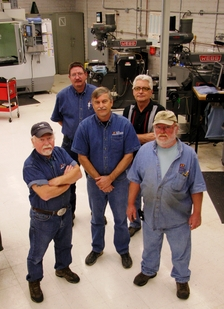 The machinists of the Engineering Technical Services Instrument and Prototype Machine Shop: (back row from left) Dave Mushier and Dennis Golabiewski; (front row from left) Dave Gillespie, Marty Johnson and Ben Schwatken. Photo: Pete Zrioka/ASU