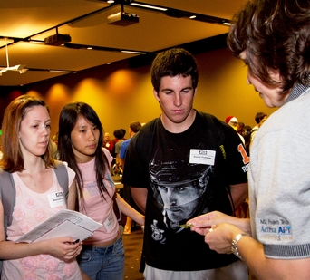 An industry representative talks to ASU freshman engineering students at Engineering Career Exploration Night. The event is designed to get first-year students thinking ahead about career planning as they embark on their college studies.