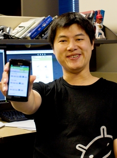 Computer science doctoral student Yunsong Meng displays a smartphone image of a social media app he helped create. The Eventor app is designed to help people organize events based on their shared interests.
