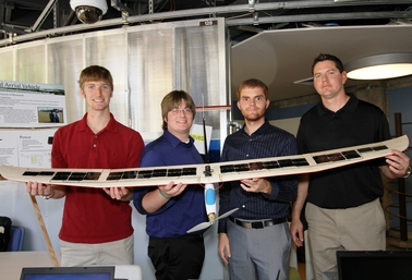 ASU students (from left) Cory Peterson, Michael Yach, Mark Garrison and Cameron Simoes display the solar-airplane model that won them the top electrical engineering senior-year design project award for the 2010-2011 school year.