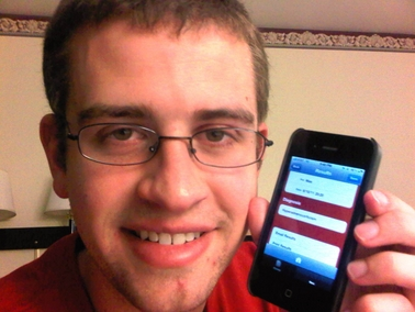 Computer science student Tim Johnsen displays the mobile application he helped develop for a business venture that is competing for a national student entrepreneurship award.