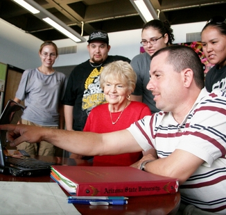 Associate engineering professor Mary Anderson-Rowland (center) meets with students in the Motivated Engineering Transfers Students Center. Photo: Blaine Coury/ASU