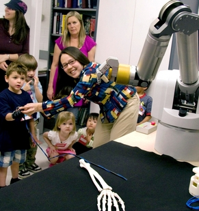 ASU mechanical engineer Veronica Santos shows pre-school students how to operate a robot hand in her Biomechtronics Lab.