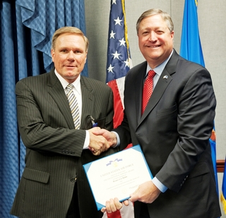 Werner Dahm (left) receives the U.S. Air Force's Decoration for Exceptional Civilian Service from Secretary of the Air Force Michael B. Donley at the Pentagon.