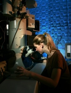 An ASU student researcher uses an electron microscope in ASU's John M. Cowley Center for High Resolution Microscopy lab, which was managed for more than two decades by John Wheatley. A room in the center was recently named for Wheatley to honor his contributions to the lab's success.