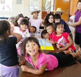 Tina Hakimi is pictured with children in an orphanage in Ensenada, Mexico, at the Camp H.O.P.E. project's first summer camp designed to inspire disadvantaged youngsters to pursue education and careers.