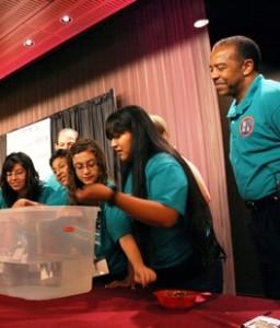 Veteran U.S. astronaut Bernard Harris guides summer science camp students through an experiment at ASU in 2009.