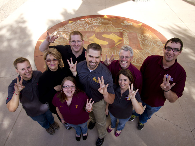 Among contributors to the decorative concrete slab project for the ASU Engineering Center courtyard {givng the ASU Sun Devil pitchfork sign) are (left to right) Chris Celani, Tamryn Doolin, Keila Lombardozzi, Brian Aronson, Josh Marriott,  associate professor James Ernzen, Kim Rahberger and Travis Goldman. Photo: Jessica Slater/ASU