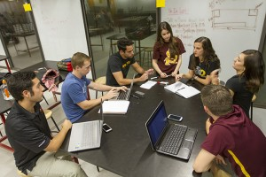 EPICS team Engineering Smiles during a brainstorming session. Photographer: Jessica Hochreiter/ASU.