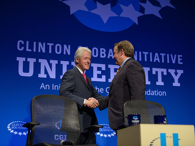 Arizona State University President Michael Crow introduced former U.S. President Bill Clinton, founding chairman of the Clinton Global Initiative, at the opening session of Clinton Global Initiative University Conference at ASU. Students in the Ira A. Fulton Schools of Engineering at ASU participated in the international event focused on developing social entrepreneurship ventures. Photographer: Andy DeLisle/ASU.