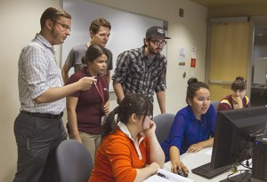 Walliman, left, with team members Ian Plumley and David Humphries, both computer science majors, test the software program in the FSE101 class of Wandaliz Torres-Garcia, center, a lecturer in the School of Computing, Informatics and Decision Systems Engineering, one of Ira A. Fulton Schools of Engineering.