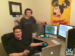 Ryan Christensen, seated, and his son, Collin, have worked together on independent gaming design.