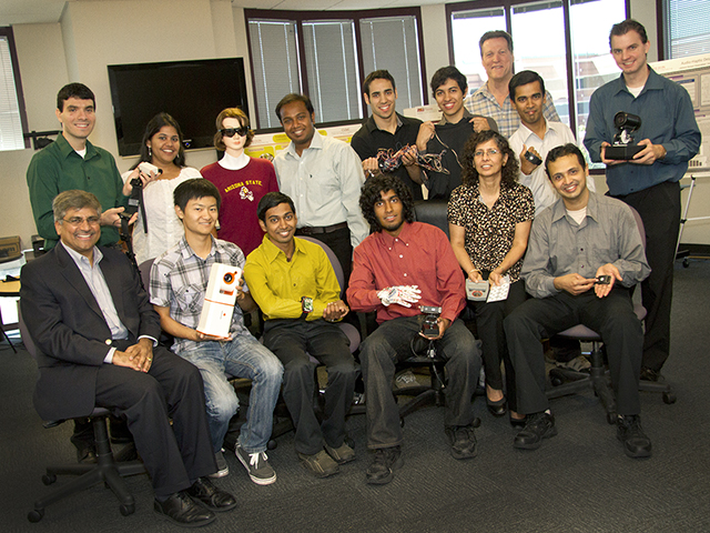 "Sethuraman ""Panch"" Panchanathan (seated at far left) is the first Arizona resident to be appointed by a president to serves on the national board that guides U.S. leaders on science and technology policy decision. Panchanathan is pictured with members of his lab team in the Center for Ubiquitous Computing (CUbiC) in ASU's Ira A. Fulton Schools of Engineering. Photography by Jessica Hochreiter/ASU"