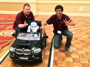Joe Boeding, left, and Bijan Fakhri, members of the ASU team at the Cornell competition, pose with the robot they taught to drive a car.
