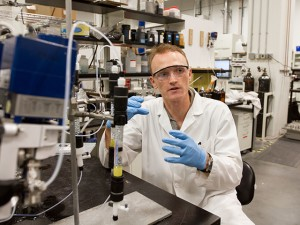 Doctoral student Mac Gifford is conducting water research, exploring the possibilities of various materials that, when applied at the nanoscale, are capable of removing contaminants. Photographer: Jessica Hochreiter/ASU.