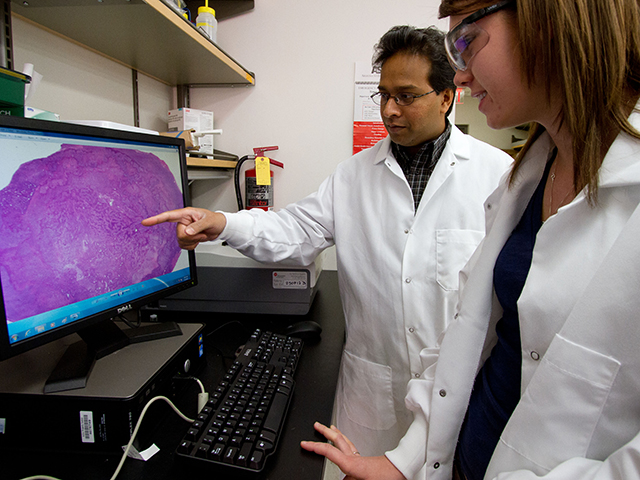 Vikram Kodibagkar (left), an assistant professor in ASU's School of Biological and Health Systems Engineering, is the recipient of a National Science Foundation CAREER award for his work to more precisely reveal the condition of body tissues, specifically tissue oxygen levels. Photo by: Jessica Hochreiter/ASU