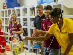 Shawn Jordan, center, assistant professor of engineering education in the Ira A. Fulton Schools of Engineering, in the STEAM labs with students. Photographer: Jessica Hochreiter/ASU.