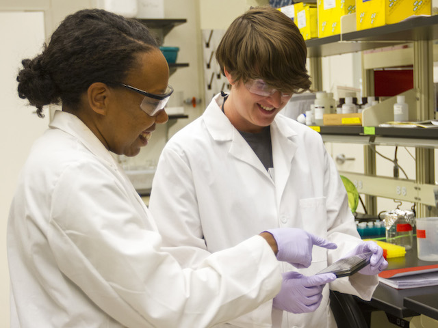 Karmella Haynes (left) is leading research to explore the capability of genetically engineered proteins to reactivate tumor suppressors inside body cells to prevent the onset of cancer, or arrest its development. Photo by Jessica Hochreiter/ASU.