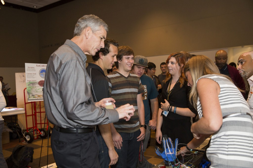 Fulton Schools Dean Paul Johnson speaks with students at Innovation Showcase