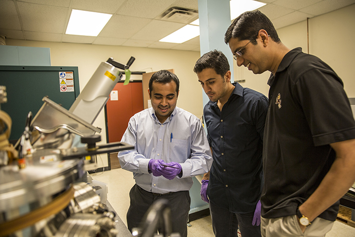 "Assistant professor Jagannathan Rajagopalan (at right) is pictured in his Arizona State University laboratory with engineering graduate students Rohit Sarkar (at left) and Ehsan Izadi, who assist with research to better understand the relationship between the microstructure and mechanical behavior of metals and alloys. The National Science Foundation is helping to support Rajagopalan's project to develop ""shape-memory"" metal alloys. Photographer: Jessica Hochreiter/ASU"