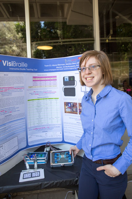 Markey Olson with her project at FURI Symposium