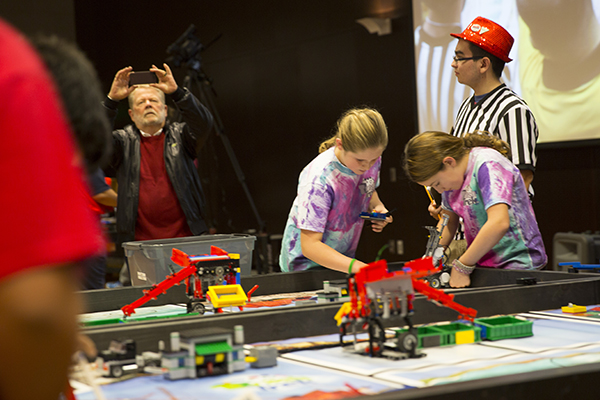 There are moments of high intensity at the Arizona FIRST LEGO League championship tournament, as youngsters concentrate on preparing their robots to perform a variety of technical maneuvers necessary to win points for their teams. Photographer: Jessica Hochreiter/ASU.