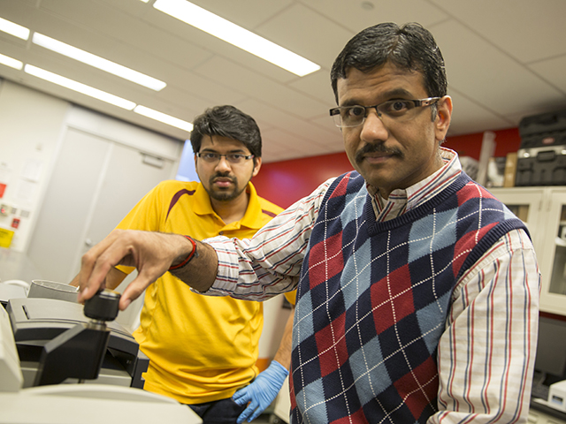 Arizona State University engineer Narayanan Neithelath (at right) will lead an international project to develop ways of making concrete pavements more durable. The work will give several ASU graduate students opportunities to gain research experience. Civil engineering doctoral student Akash Dakhane (at left) will assist Neithalath with tasks such as using infrared spectroscopy to identify the composition of phase-change materials that will be used to development new kinds of pavement. Photography: Nora Skrodenis/ASU