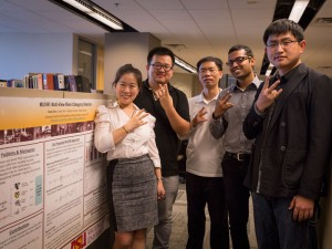Jingrui He and four of her graduate students in front of a research poster