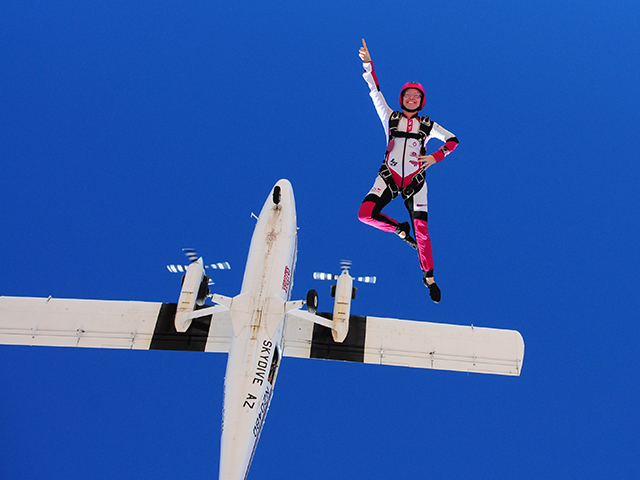 Nadia Kellam skydiving in Eloy, Arizona in October 2014. In addition to skydiving she is a flying trapeze artist and a motorcyclist. Photographer: Robin Kellam