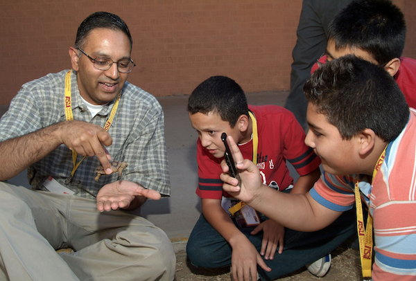 ASU Associate Professor and Assistant Dean of Engineering Education Tirupalavanam Ganesh uses a small tortoise to explain to young students how the animal's natural behaviors can provide answers to ways to design technologies that solve human problems.