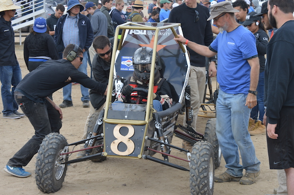 ASU Sun Devil Racing Development club members prepare their car for an endurance race at one of the Baja SAE off-road vehicle competitions sponsored by the Society of Automotive Engineers. Photograph courtesy of Sun Devil Racing Development.