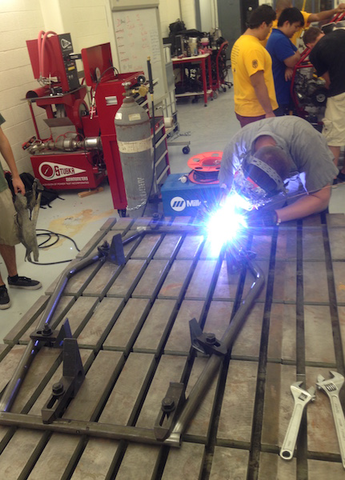 Sun Devil Racing club members gain valuable engineering experience by honing modeling, design, and manufacturing skills in their Baja car workshop. Photograph courtesy of Sun Devil Racing Development.