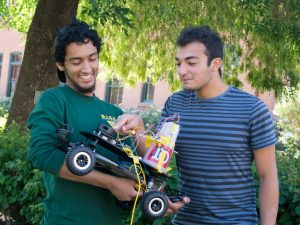 Ridhwaan and Moussa with the Old Main QT Rover.
