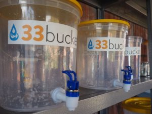 33 Buckets' filtration system uses a system of containers and swappable filters to meet each community's specific water needs.