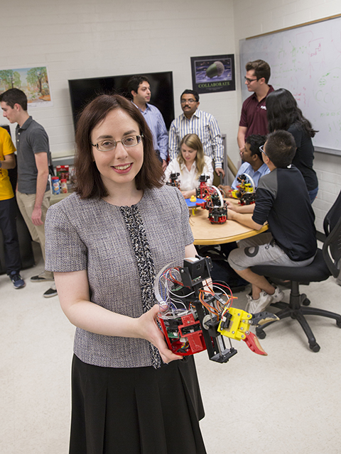 Spring Berman, an assistant professor of mechanical and aerospace engineering, is developing techniques for modeling, optimization and control of very large collectives of individual robots, or robot swarms. Photographer: Jessica Hochreiter/ASU