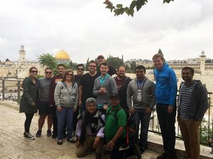 The study abroad group stops for a photo in historic Jerusalem. Photo courtesy of Shaun Wootten