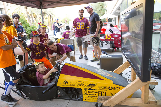 Members of ASU's chapter of the Society of Automotive Engineers gave guests the opportunity to take a Formula Gulf 1000 for a virtual test drive at their exhibit. Photographer: Jessica Hochreiter/ASU