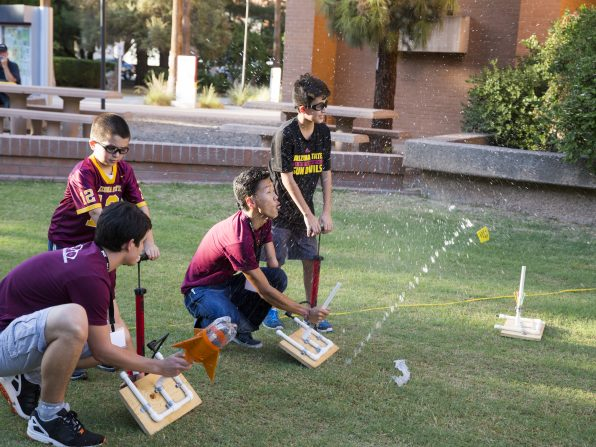 Members of the student organization Daedalus Astronautics launch bottle rockets with guests at the Fulton Schools' Block Party, Oct. 22, 2016. Photographer: Jessica Hochreiter/ASU