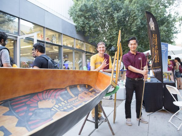 Students with ASU's chapter of the American Society of Civil Engineers show off their always popular concrete canoe at the Fulton Schools' Block Party, Oct. 22, 2016. Photographer: Jessica Hochreiter/ASU