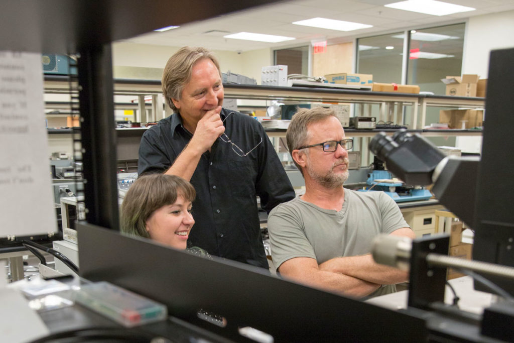 Assistant Professor Hugh Barnaby (right) and Professor Michael Kozicki (center) apply their expertise in radiation effects and memory to test next-generation neuromorphic computing architectures for use in critical applications where radiation is a likely concern.