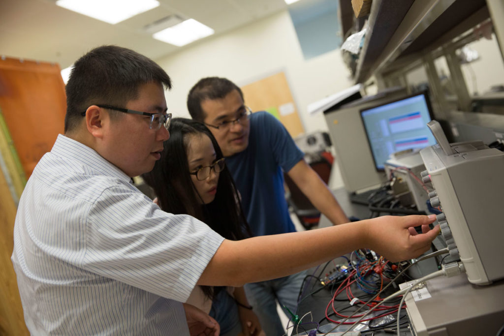 Assistant Professor Shimeng Yu (left) was recently awarded a National Science Foundation CAREER Award for his work related to neuro-inspired computing. He brings his expertise in higher-level computing architectures to help the team design neuromorphic architectures to test under various types and levels of radiation.