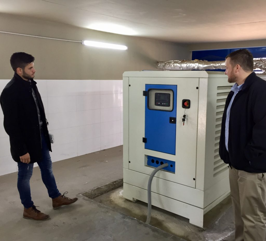 Hasan Daouk of Zero Mass Water and ASU Professor Rhett Larson discuss placement of H2O for Humanity's AquaSafi-2000 water purification system in the existing kiosk at an out-of-use well in Qubbe, Lebanon. Photo courtesy of Ashley St. Thomas/ASU Walton Sustainability Solutions Initiatives