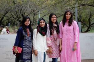 Photo of four girls standing in a row with a caption of USPCAS-E Scholars, Left to right: Farah Akram, Anam Zahra, Maham Akhlaq, Atoofa Zainab, Photographer: Erika Gronek/ASU