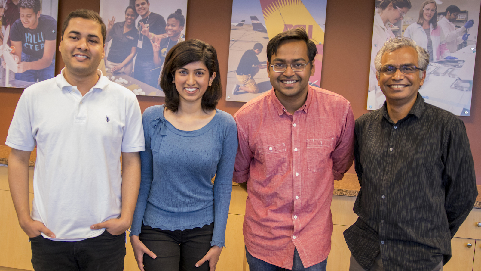 "Photo of four people in a row with a caption of "" The Æffective Robotics team members with their mentor,Subbarao Kambhampati, a professor of computer science and engineering. Photographer: Marco-Alexis Chaira/ASU."""