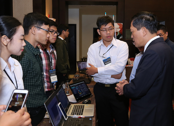"""Photo of students demonstrating on a laptop with a caption of """"Winners of the 2017 National Instruments Innovation Design Competition for Young Entrepreneurs showcase their winning internet of things home cardiac surveillance system, """"CASSANDRA."""""""""""