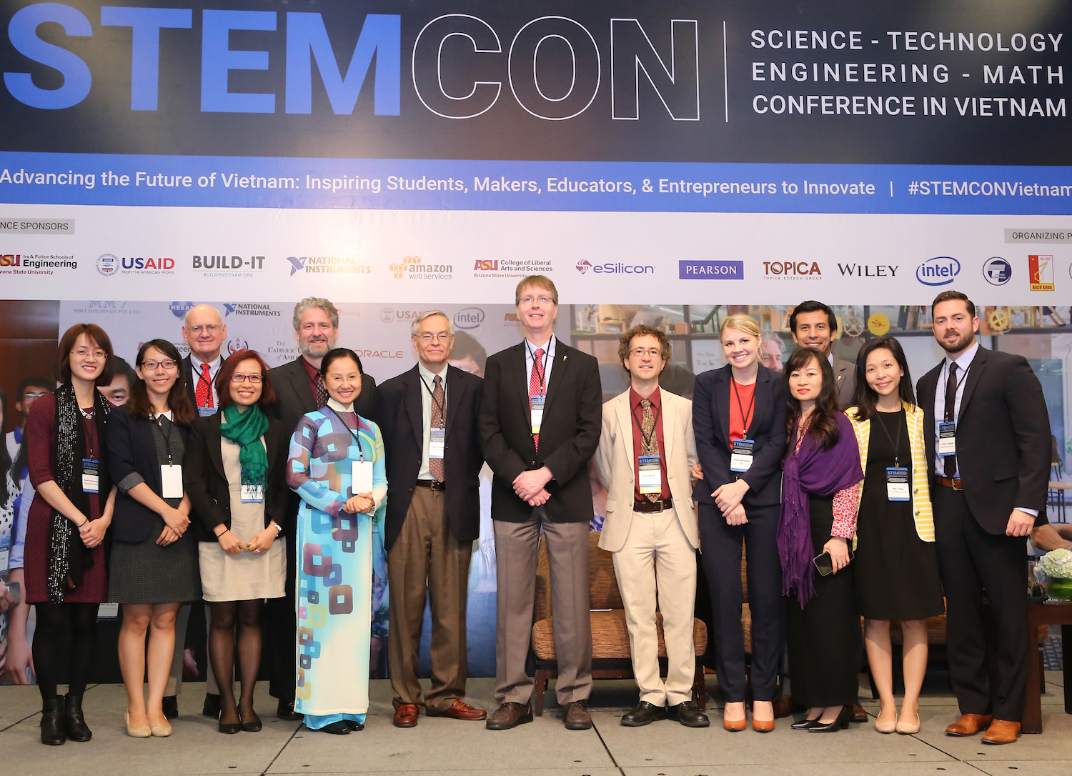 "Photo of group standing with a caption of ""ASU staff with USAID Vietnam Social Development Unit Chief Ezra Simon (Sixth from right) at STEMCON. From Left:  Huong Nguyen, Thanh Ta, Marcus Ingle, Thao Tran, David Benson, Phuong Nguyen, Scott Danielson, Kyle Squires, Ezra Simon(USAID), Sasha Stinchfield, Phuong Anh Tran, Octavio Heredia, Cristal Ngo, Jose Quiroga. (Photo courtesy of HEEAP.)"""
