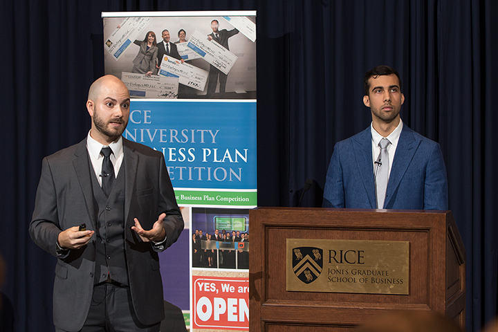 Photo of two men standing next to a lectern with a caption of Left, Peter Firth, CEO of Swift Coat and Jonathan Bryan, an electrical engineering doctoral student, represented the venture at the Rice Business Plan Competition, considered one of the top entrepreneurial competitions for graduate-level ventures. Photo courtesy of Peter Firth""