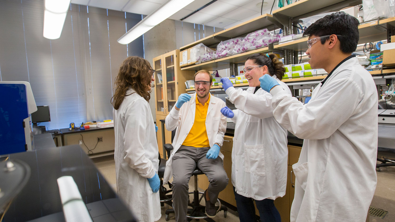 Kaleia Kramer (second from right), recent biomedical engineering graduate, worked with other students in the lab as part of her research requirement for the Grand Challenge Scholars Program.