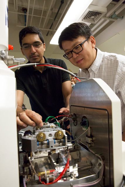 "Photo of Yongming Liu and Fraaz Tahir working in a lab with a caption of ""Professor Yongming Liu (right) pictured with Fraaz Tahir, a mechanical engineering doctoral student. Liu is leading a $10 million project funded by NASA to make next-generation aviation safer and more efficient. Photographer: Pete Zrioka/ASU"""